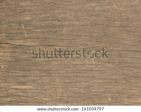 Old brown wood texture, with a pattern of shallow horizontal cracks in its surface. - stock photo