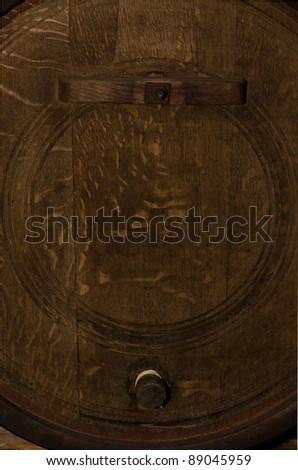 Old, brown, wooden barrel for wine - stock photo