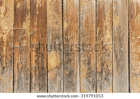 Old brown wooden wall with a shabby paint - stock photo