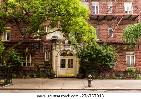 Old brownstone apartment building in Manhattan, New york city - stock photo
