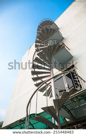 Old building and fire escape stair - stock photo