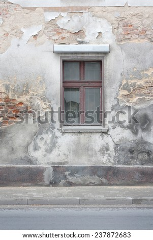 old building facade view, broken window as grunge urban background - stock photo