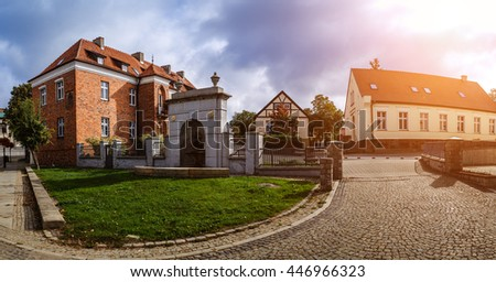Old building of red brick. Gniezno, is a city located in northern Poland, on the Brda and Vistula rivers. - stock photo