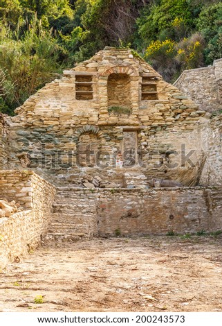 Old building ruins after an earthquake in Megistis Lavras port (arsanas) in Holy Mount Athos - stock photo
