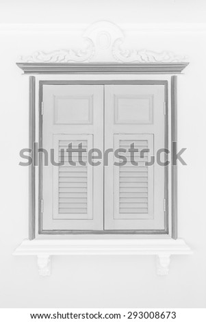 Old building window in Thai buddhist temple, black and white - stock photo