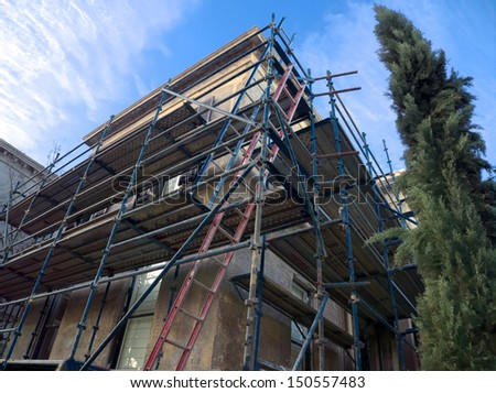 old building with scaffolding undergoing repair - stock photo
