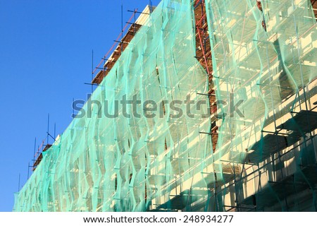 Old building with staffolding on a wall. - stock photo