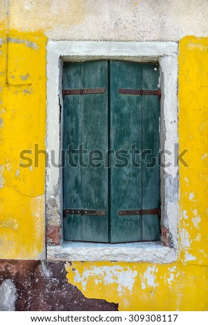 Old building with vintage of window with shutters in European city - stock photo