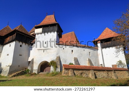 Old buildings of fortified church (UNESCO world heritage), Viscri village, Romania - stock photo