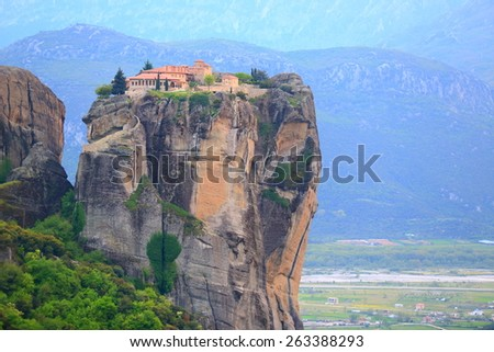 Old buildings of the Holy Trinity monastery elevated high above valley, Meteora, Greece - stock photo