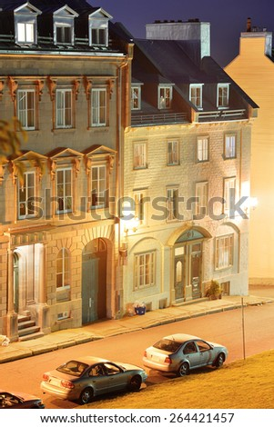 Old buildings on street at night in Quebec City - stock photo
