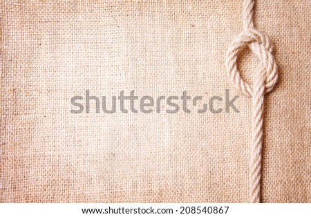 Old burlap and knot - stock photo