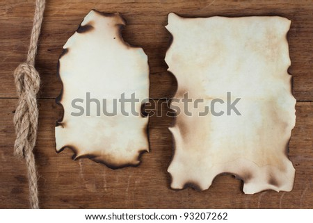 Old Burnt Paper on Wood background - stock photo