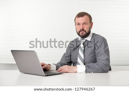 old business man with laptop - stock photo