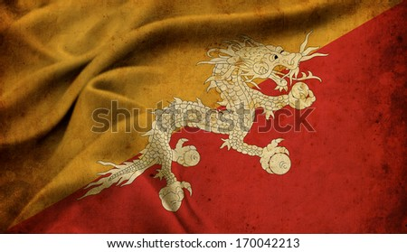 Old Butan flag on a detailed fabric - stock photo
