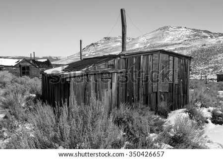 Old cabin in black and white, Bodie, California, USA. - stock photo