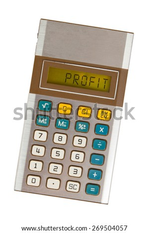 Old calculator showing a text on display - profit - stock photo