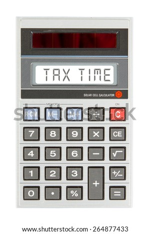 Old calculator showing a text on display - tax time - stock photo