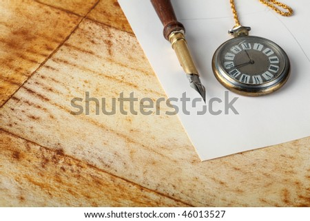 old calligraphy pen on paper - stock photo