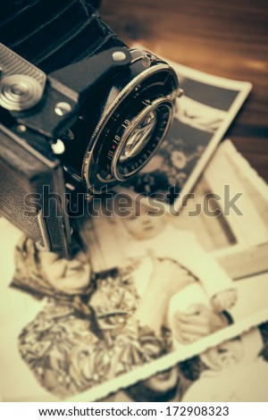 old camera and old pictures - stock photo