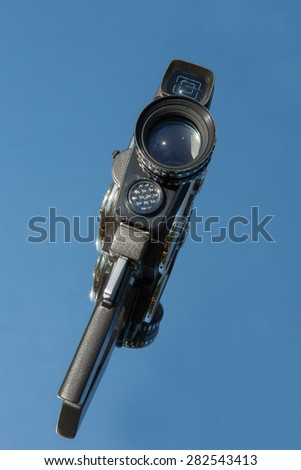 Old camera on a background of blue sky - stock photo