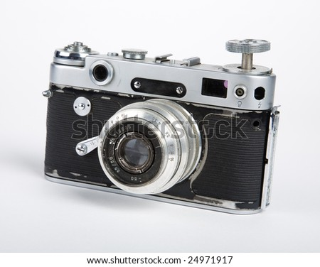 old camera on a white background - stock photo