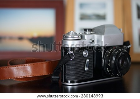 Old camera on wooden table. - stock photo