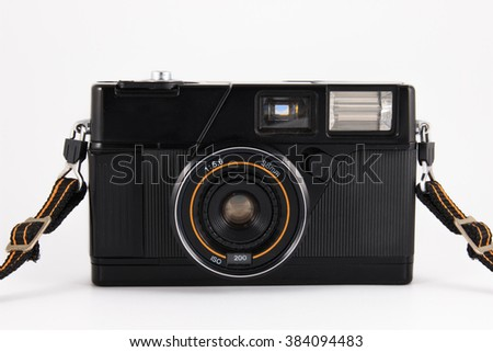 Old camera, vintage camera films popular in the past on white background. - stock photo