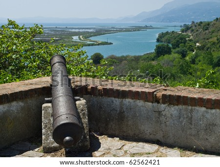 Old cannon at Butrint fortress in Albania. - stock photo