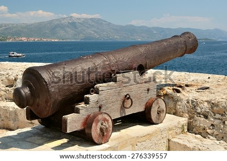 Old cannon at old fortress in medieval town Korcula in Croatia - stock photo