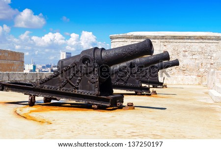 Old cannon battery at the spanish fortress of El Morro in Havana - stock photo