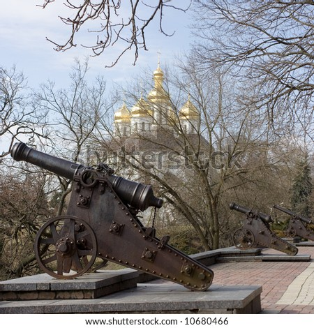 Old cannon's in Chernigov. On background park and cossack's church. - stock photo