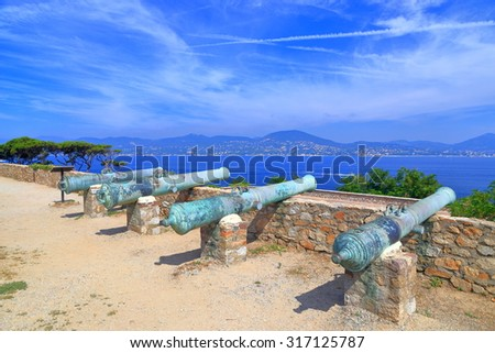 Old canons pointing to the open sea in Saint Tropez, French Riviera, France - stock photo