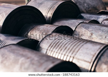 old cans lying on the sun - stock photo
