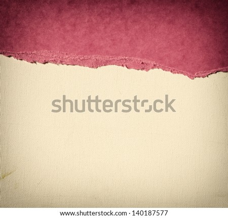 old canvas texture background with delicate stripes pattern and pink vintage torn paper - stock photo