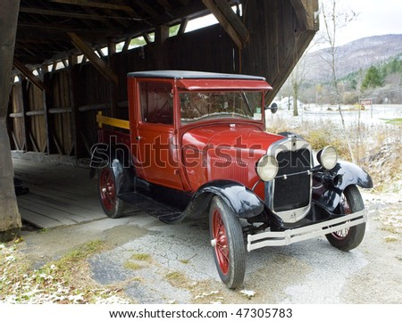 old car at covered wooden bridge, Vermont, USA - stock photo