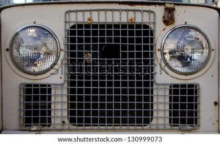 Old car headlight. - stock photo