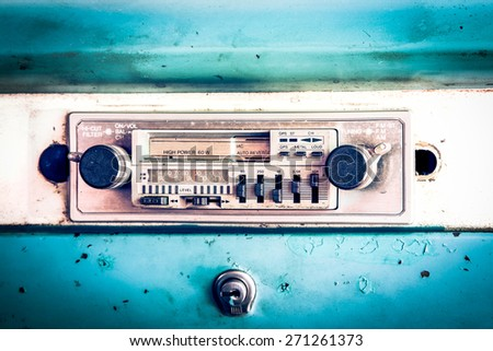old car radio in vintage car - stock photo