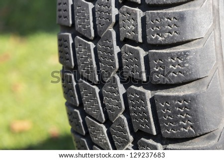Old car tire outdoor. - stock photo