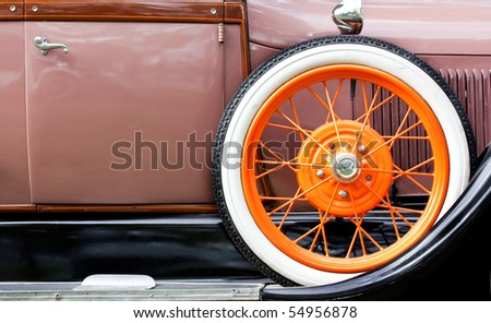 Old car with orange tire profile - stock photo