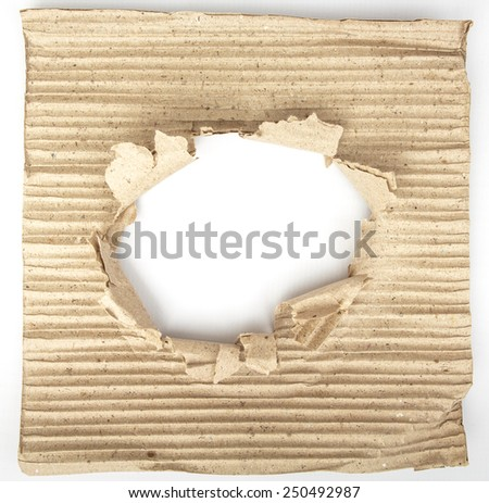 Old cardboard paper with a big hole in the middle - stock photo