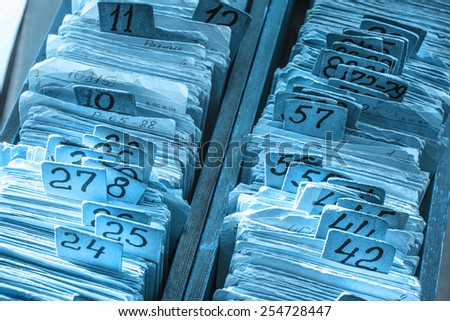 Old cards index catalog with numbers in toning - stock photo