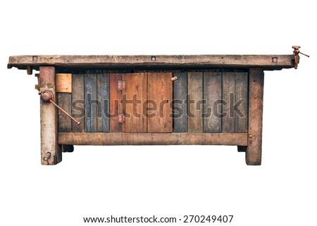 Old carpenter wooden work bench isolated on a white background - stock photo