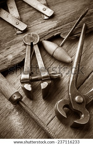 old carpenter workshop with vintage tools,sepia image - stock photo
