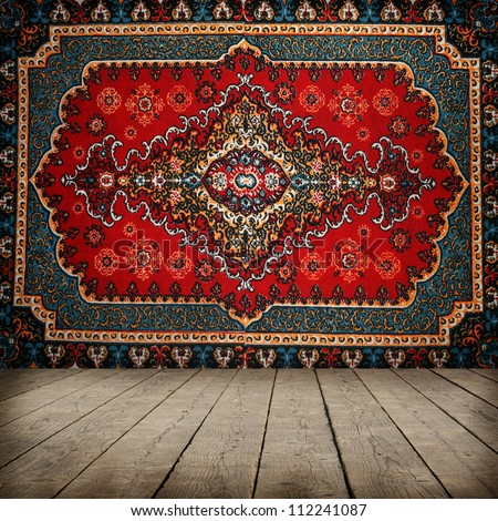 Old carpet on wall - stock photo
