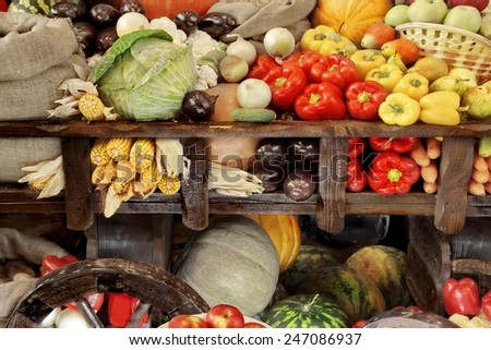 Old Cart With harvest of Vegetables Background - stock photo