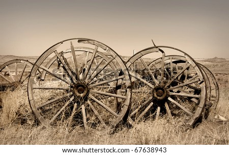 Old carts in a Ghost town near Cody, Wyoming - stock photo