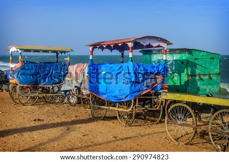 Old carts on beach in Pondicherry, Tamil Nadu, India - stock photo