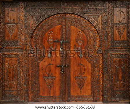 old carved door - stock photo