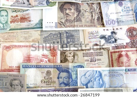 Old cash money from different countries around the world. - stock photo